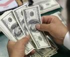 انخفاض طفيف بسعر صرف الدولار ببورصة الكفاح واستقراره بالاسواق المحلية