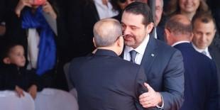 الحريري يعلن تعليق استقالته