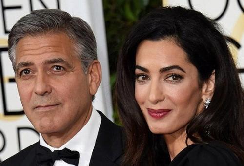 جورج كلوني وزوجته أمل يستضيفان لاجئاً عراقياً في منزلهما